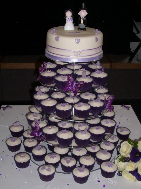 Wedding Cake Extraordinary White Dark Purple Theme Cupcake Tower Wedding Cake With Cute Purple Butterflies And Lovely Bride And Groom Topper Beautiful Cupcake Tower Wedding Cake Design Inspirations Cu