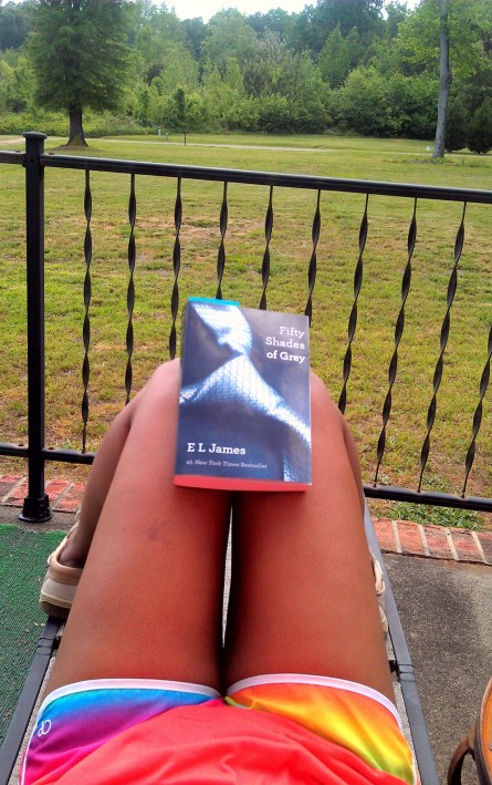 Reading Fifty Shades Of Grey On The Porch