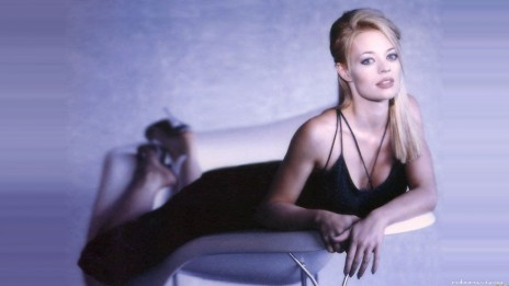 Jeri Ryan Sprawled On Her Front On Chair In Classy Dress And Heelsscale Border