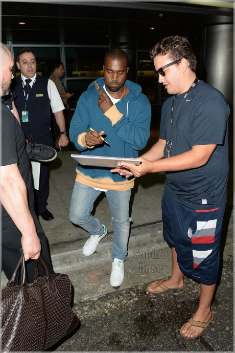Kanye West Signs Autographs Inf