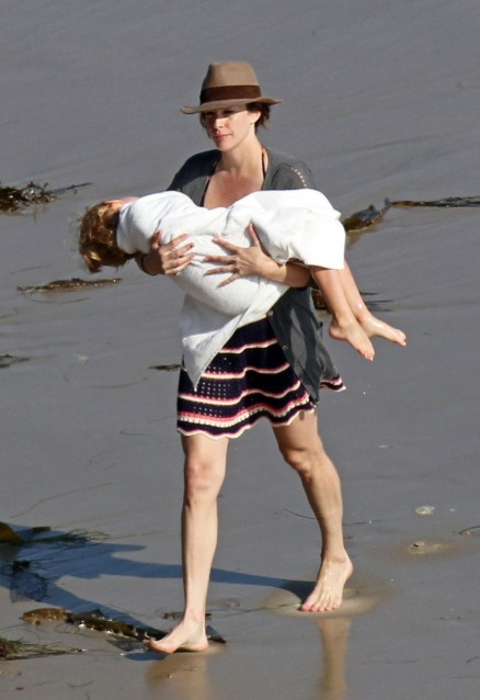 Liv Tyler Carries Her Beach Boy Beach