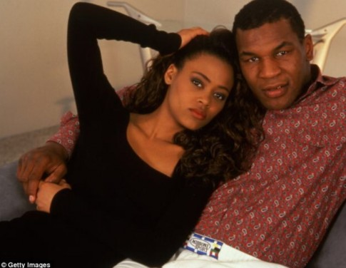 Image Of Actress Robin Givens And Boxing Champ Mike Tyson Sitting On Couch Arm In Arm And Robin Is Running Her Fingers Through Her Long Hair Facing Camera